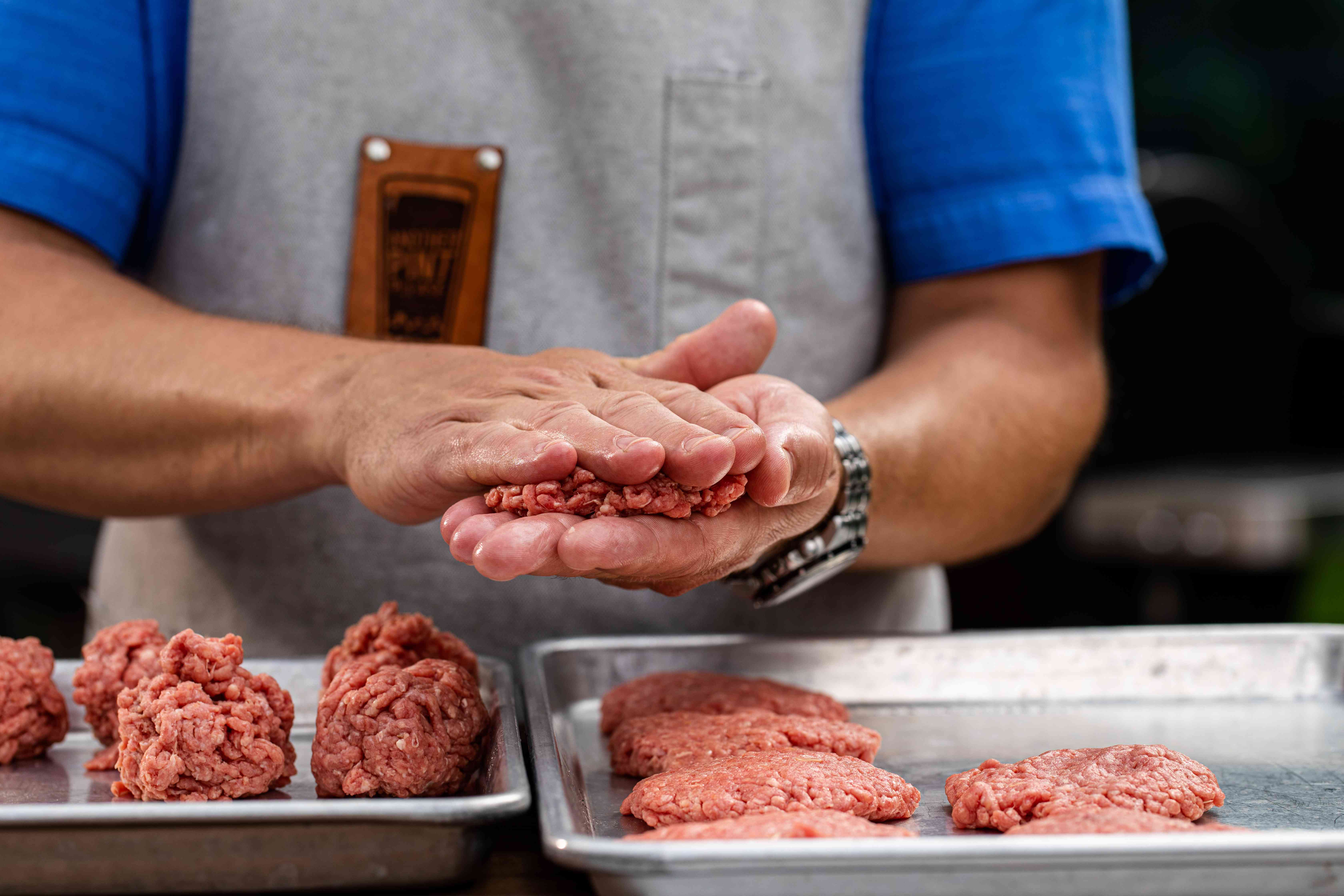 Pressing ground beef into patties for a copy cat Juicy Lucy burger
