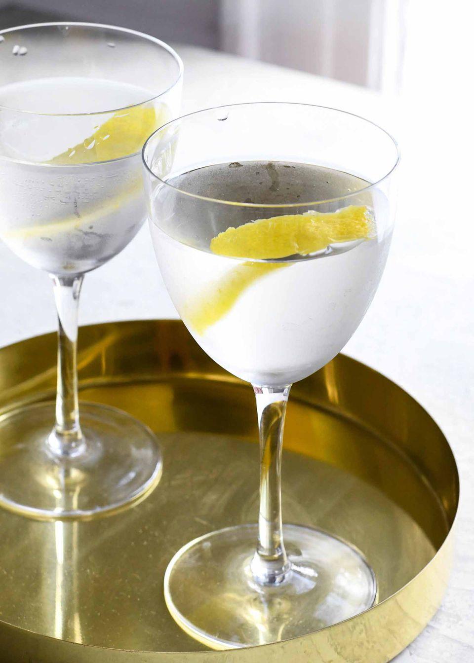 Dry Martini Recipe vodka martini in glass with lemon peel garnish