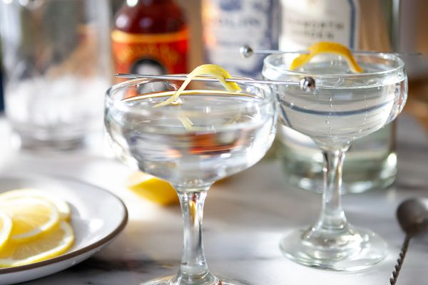 Close up of two Gin Martini Cocktails garnished with lemon twists.