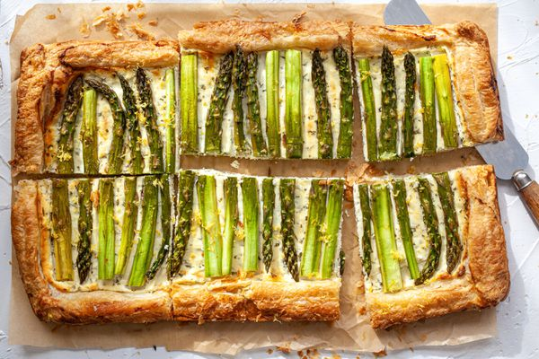 Asparagus Tart with Goat Cheese and Lemon cut into slices.