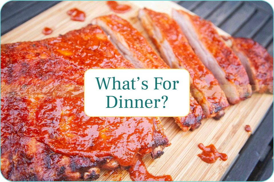 """""""What's for Dinner?"""" with a platter of ribs set behind the caption."""