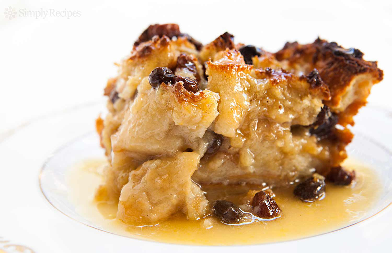 Best Bread Pudding served on a plate with bourbon sauce