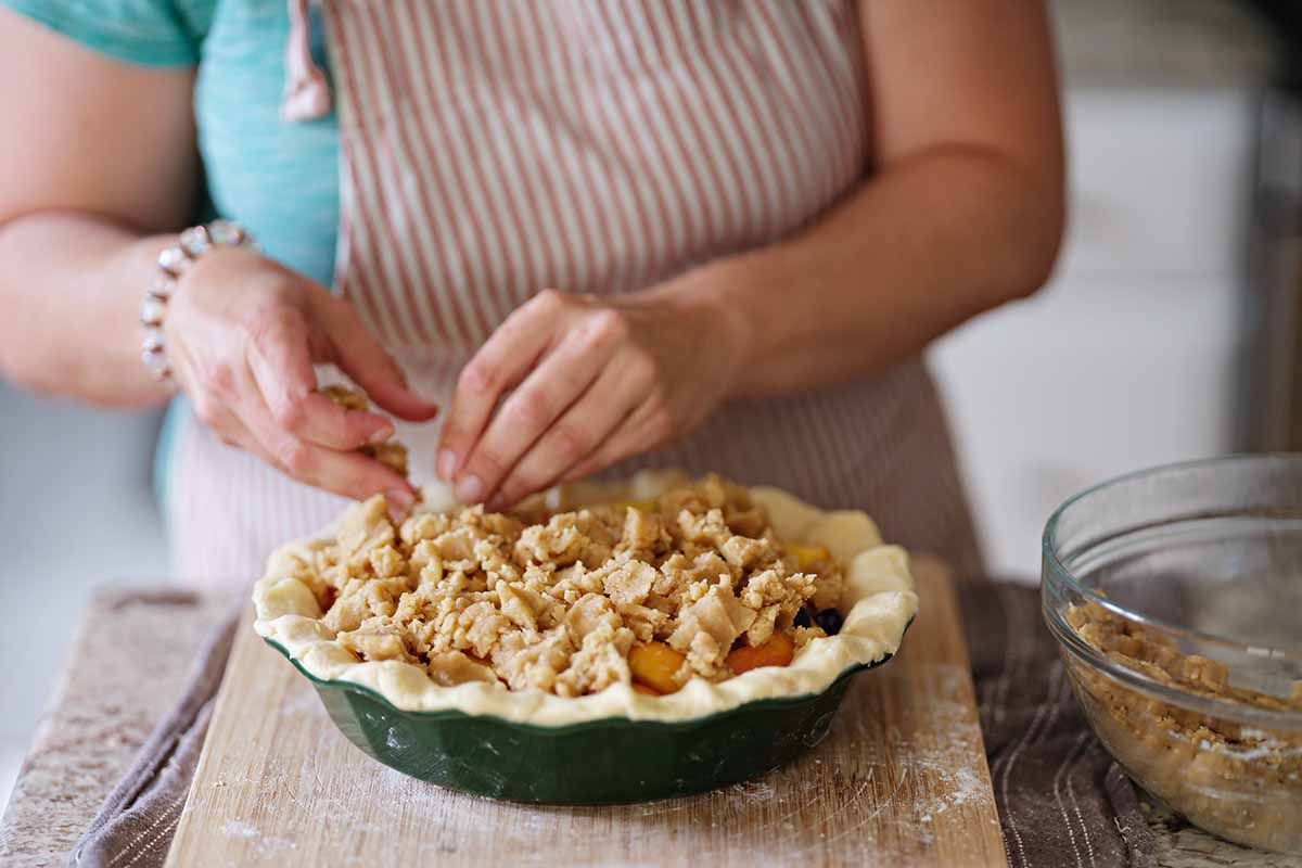 Peach and blueberry pie recipe fill the top with crumbs