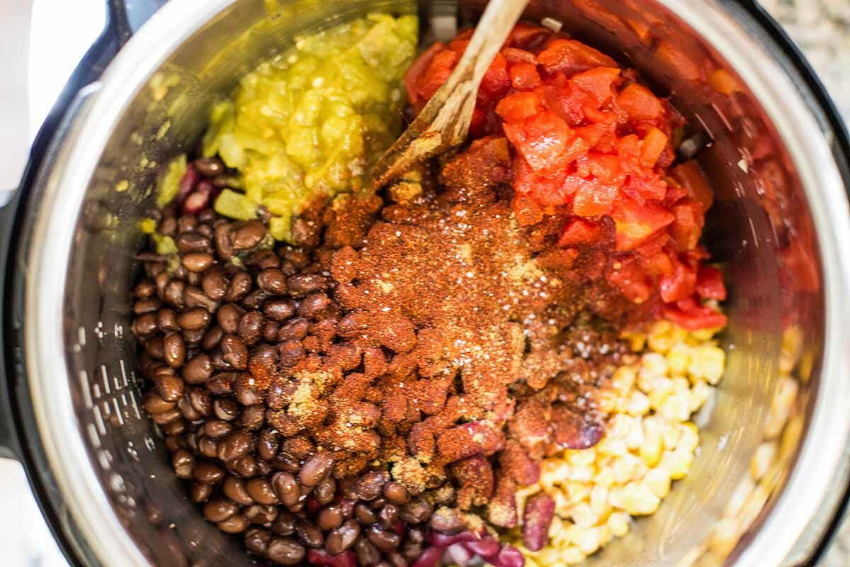 Easy Taco Soup in Pressure Cooker add the stock, beans, tomatoes