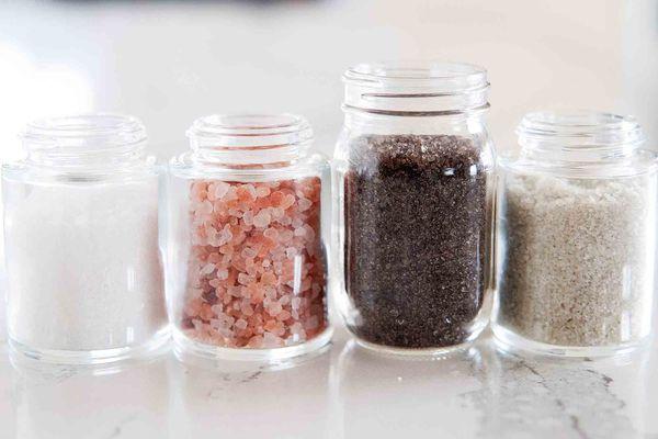Jars of salt sel de gris, smoked salt, pink himalyan sea salt and white flaky sea salt