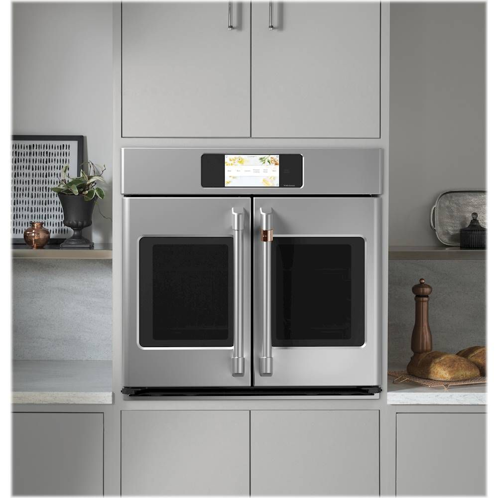 The Cafe CTS90FP2NS1 30 in. Smart Single Electric French-Door Wall Oven can be flushed with your cabinets and looks incredibly chic.