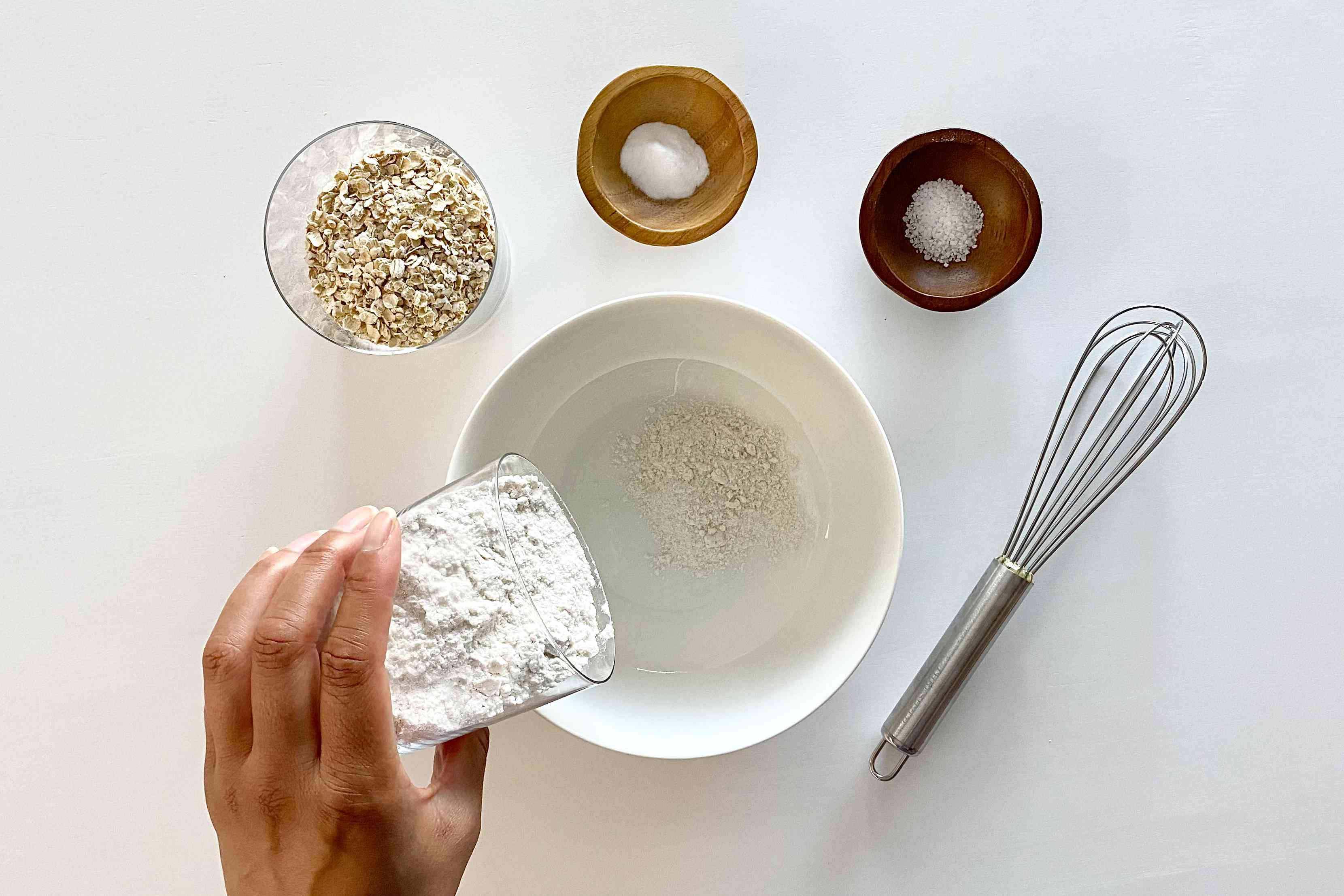Adding flour to a bowl to make Bar Cookies of the Gluten Free Monster Variety.