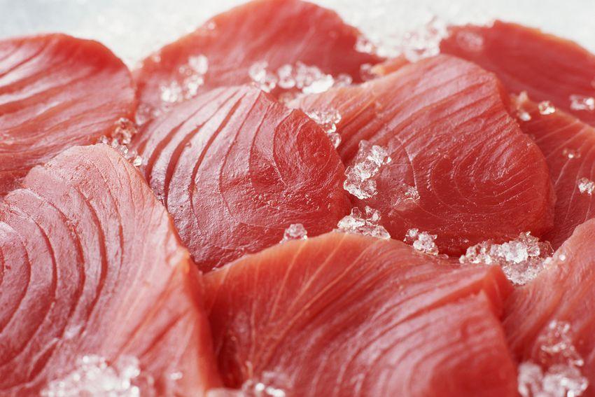 Raw sliced tuna steaks on crushed ice