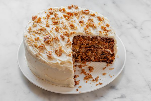 An easy carrot cake recipe with a couple slices missing from the cake.