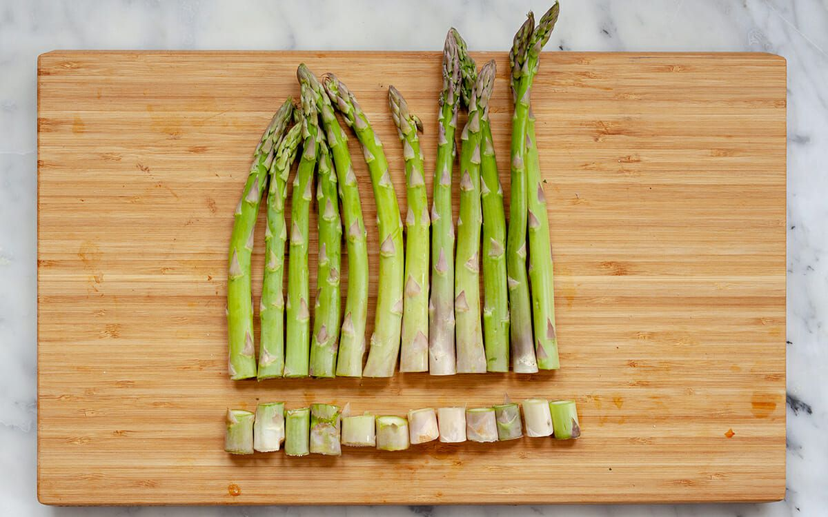 How to Make Bruschetta - asparagus on cutting board with bottom trimmed off