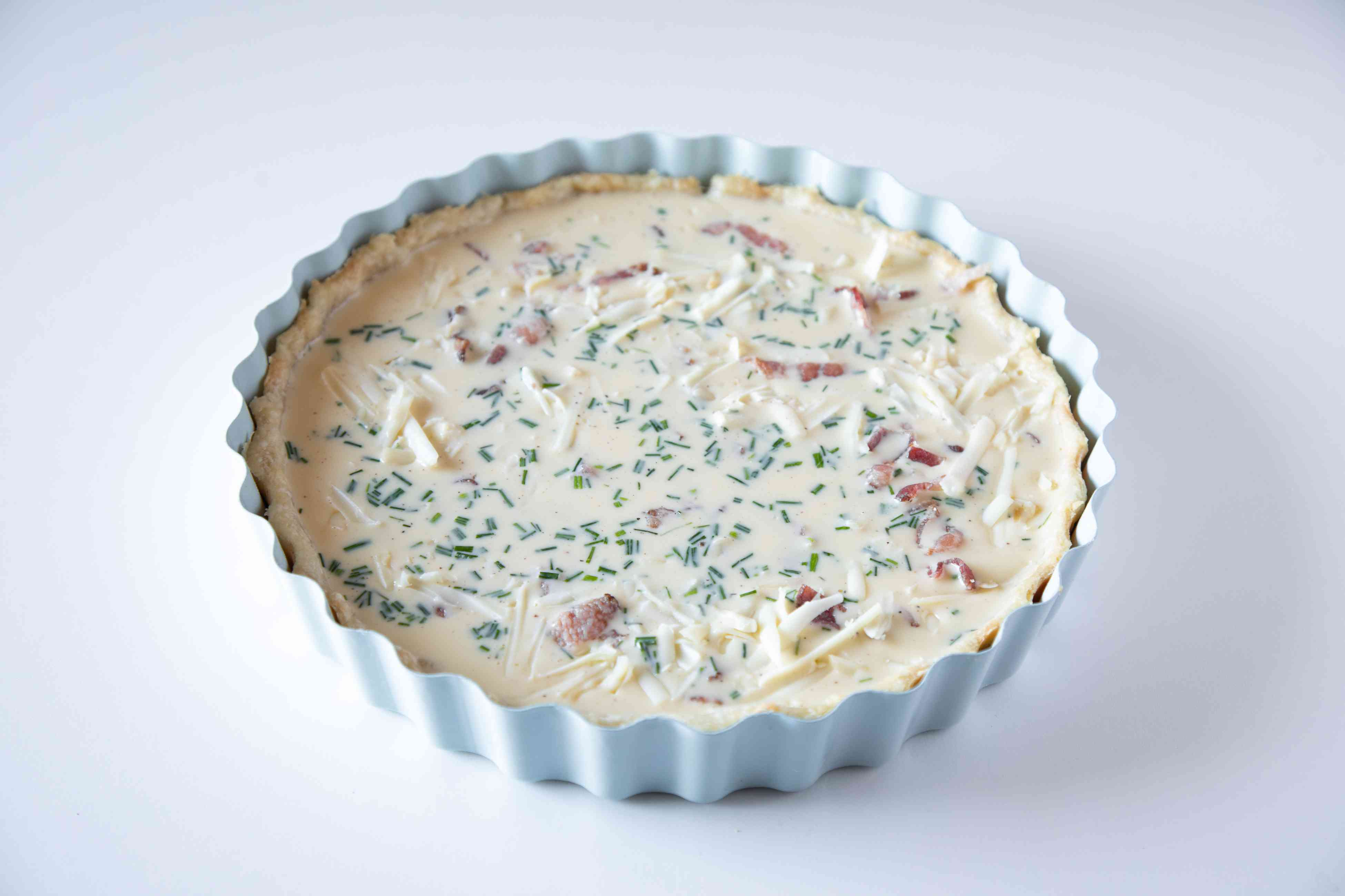 A basic quiche recipe ready for the oven.