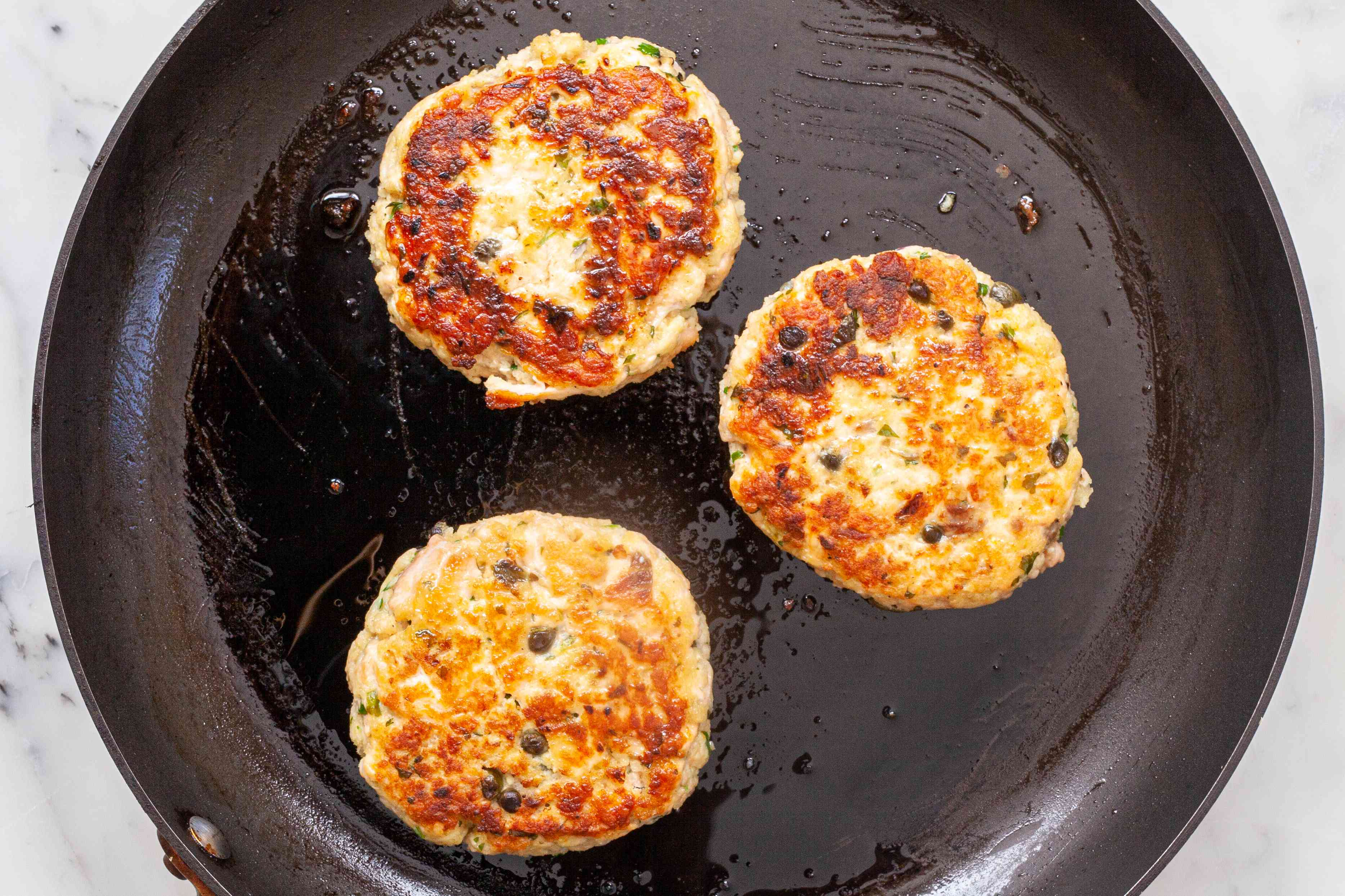 How to cook the perfect salmon burger in a skillet.