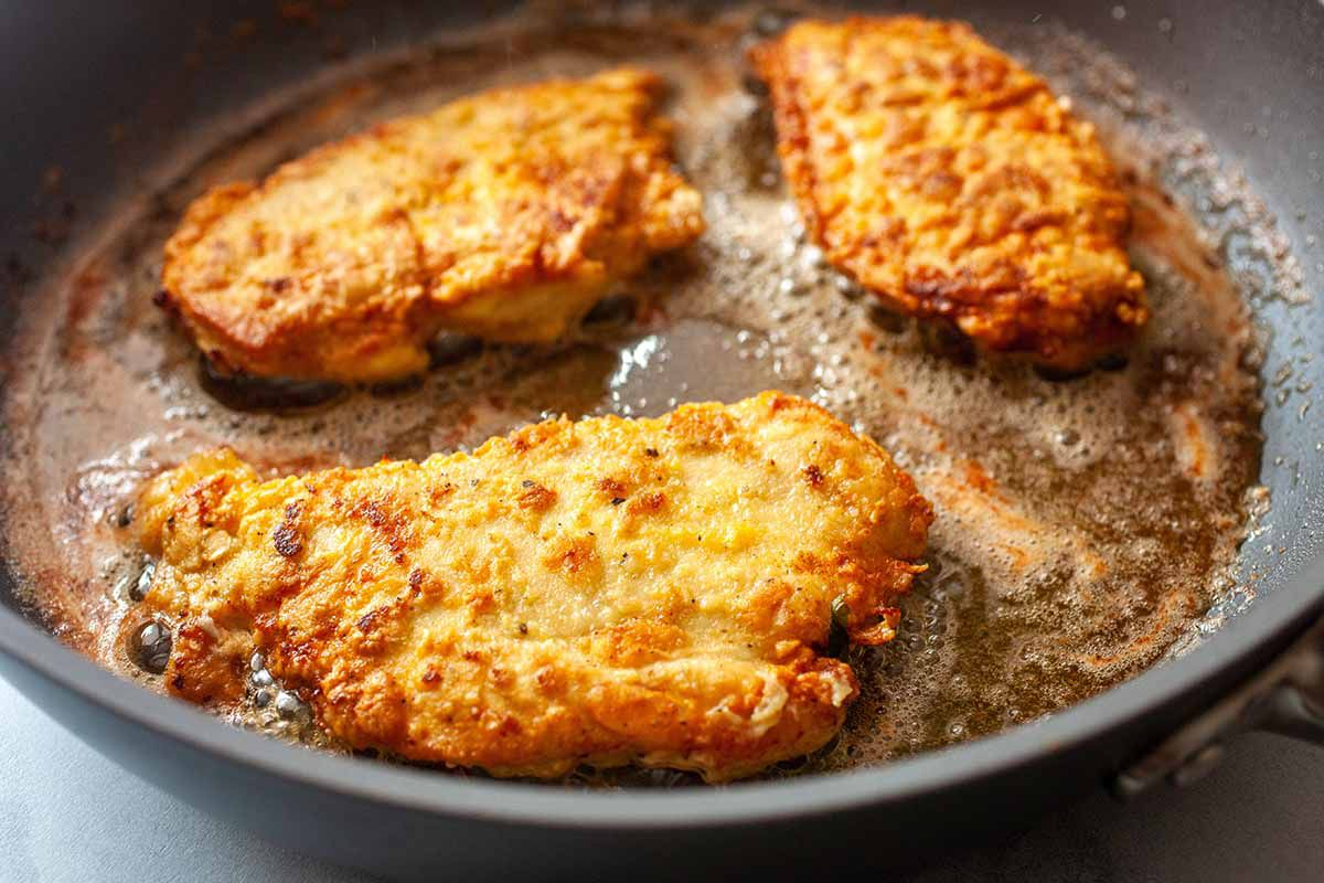 Easy Chicken Piccata with Pasta fry the chicken