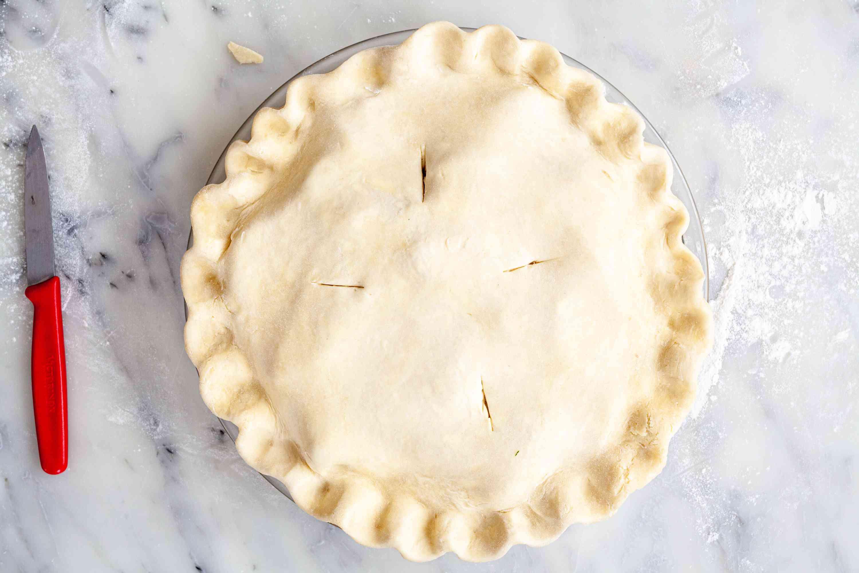 Cutting slits in a homemade pie crust.