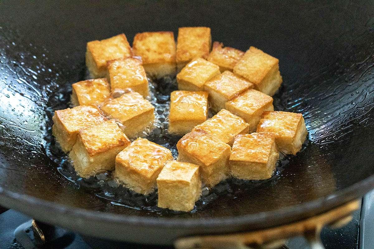 Cubed tofu in a wok to make Healthy Stir Fry.