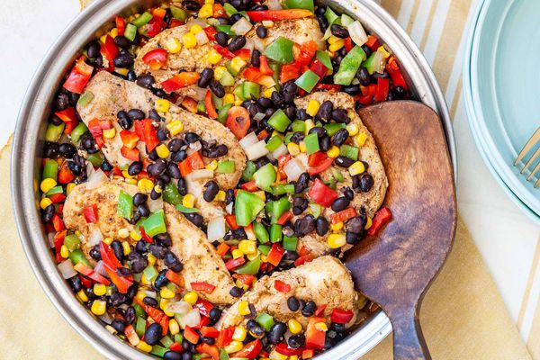 Easy Skillet Chicken - close up of chicken tenders with black beans, corn, and red and green bell peppers