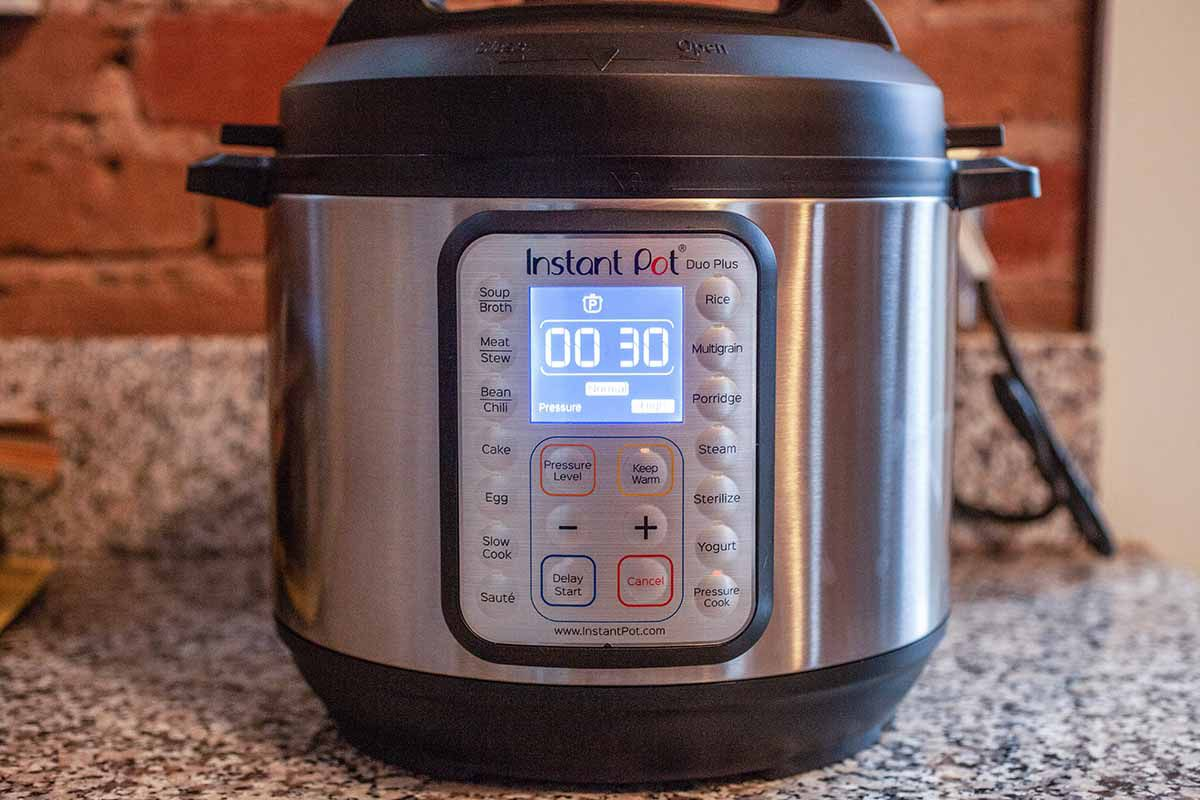 How to Make Chicken Stock in the Instant Pot - an instant pot with the digital timer reading 30 minutes