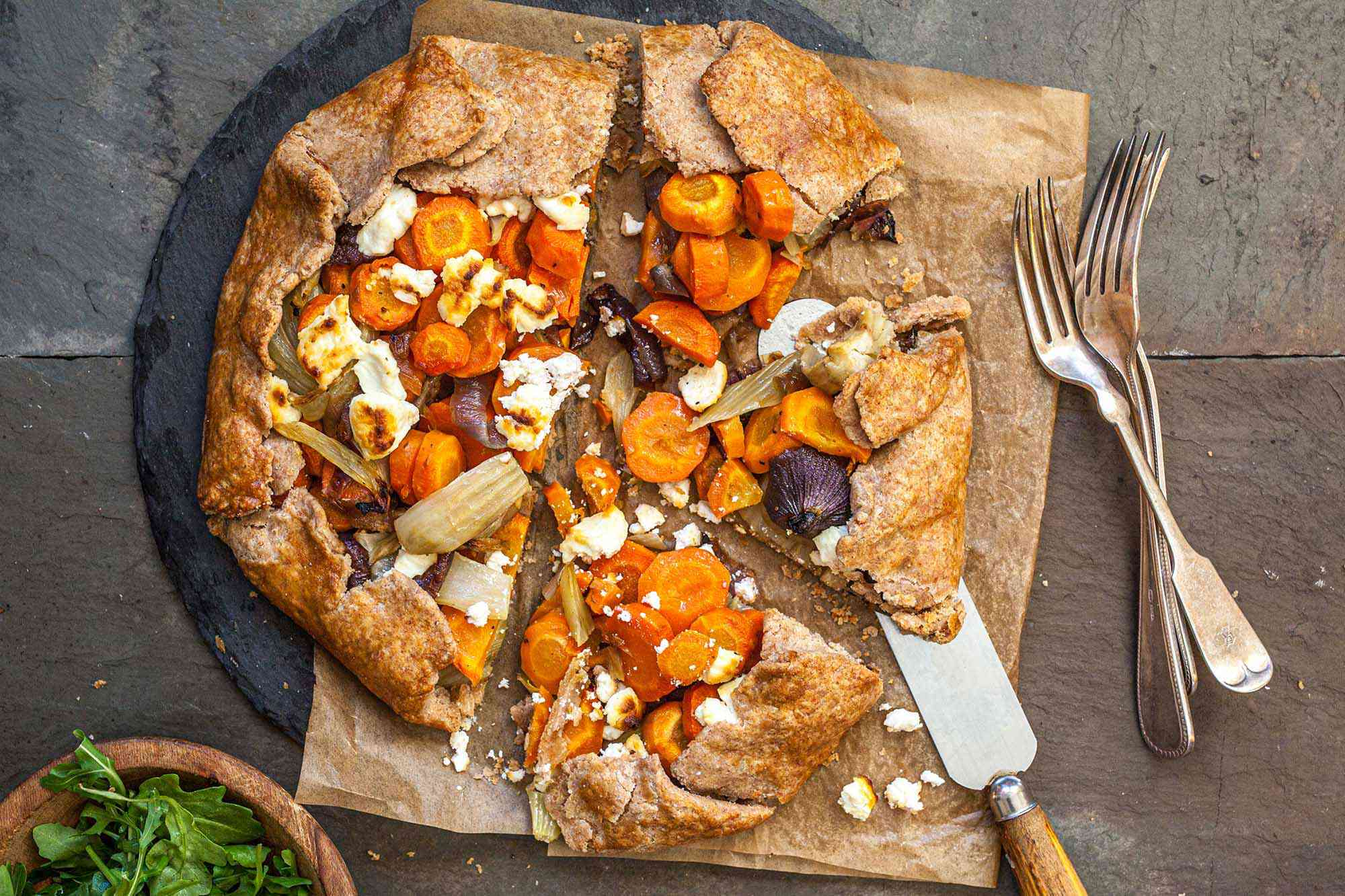 Rustic Winter Vegetable Galette cut into slices.