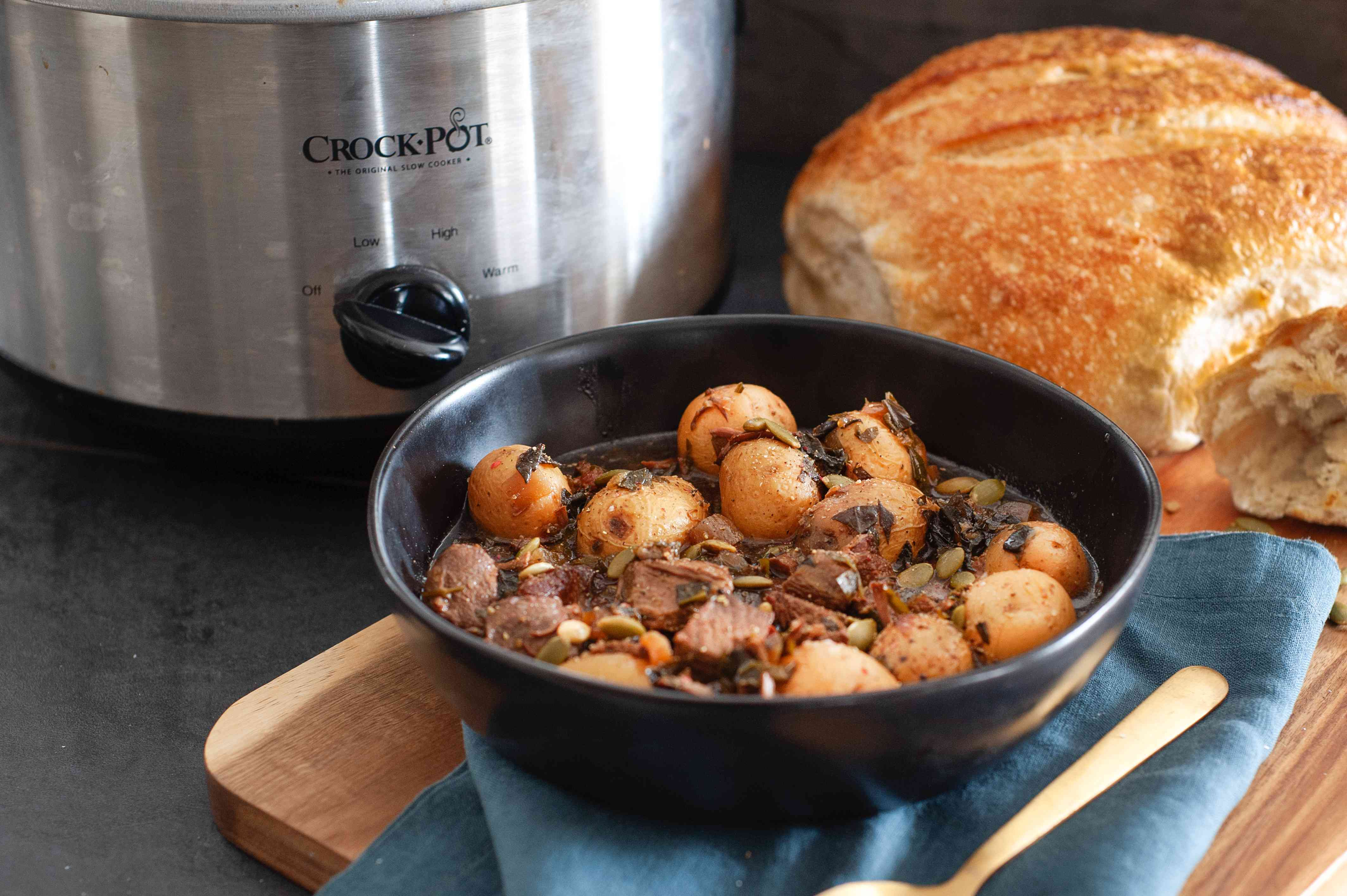 Lamb Stew with Pomegranate Molasses in a bowl with bread.