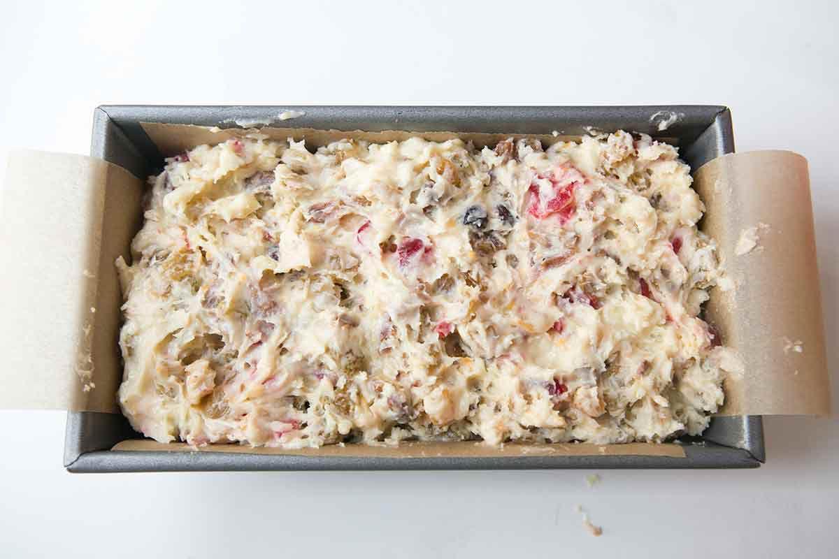 Transfer the fruitcake batter to a baking pan