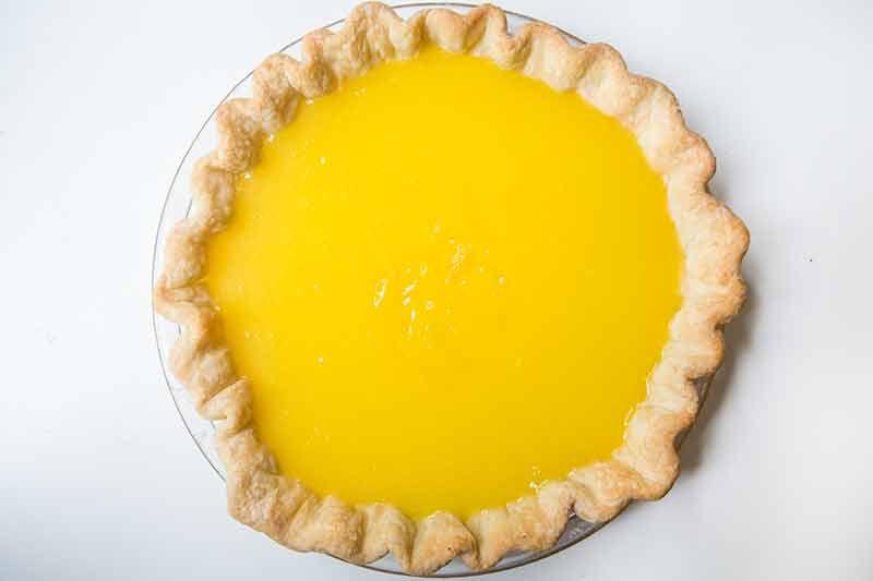 Pie shell filled with lemon curd filling for lemon meringue pie