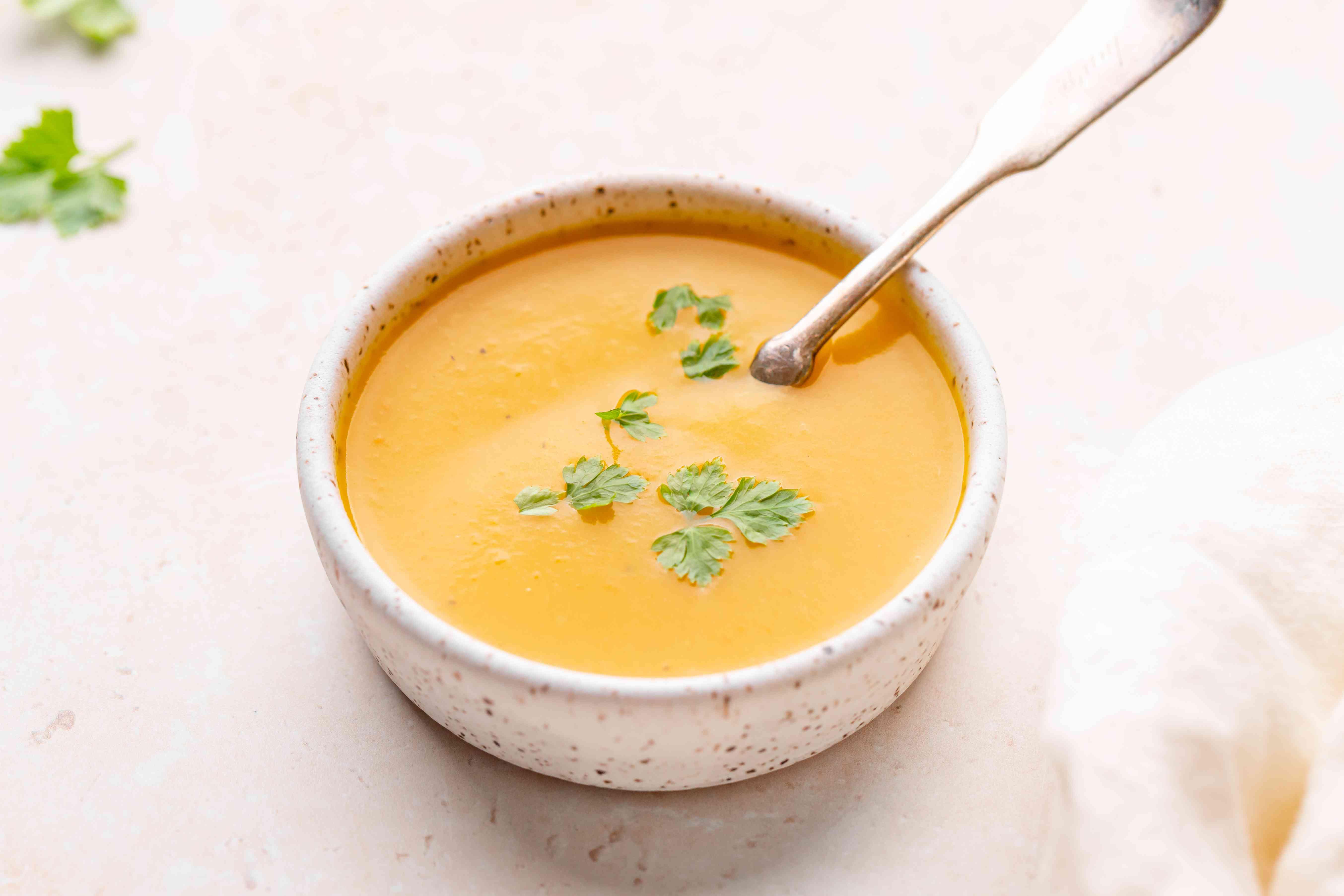 A bowl of butternut swuash soup.
