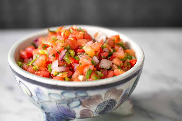 tomato salsa in a bowl showing chopped tomatoes and onion