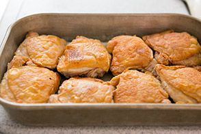 place chicken in roasting pan and pour in broth