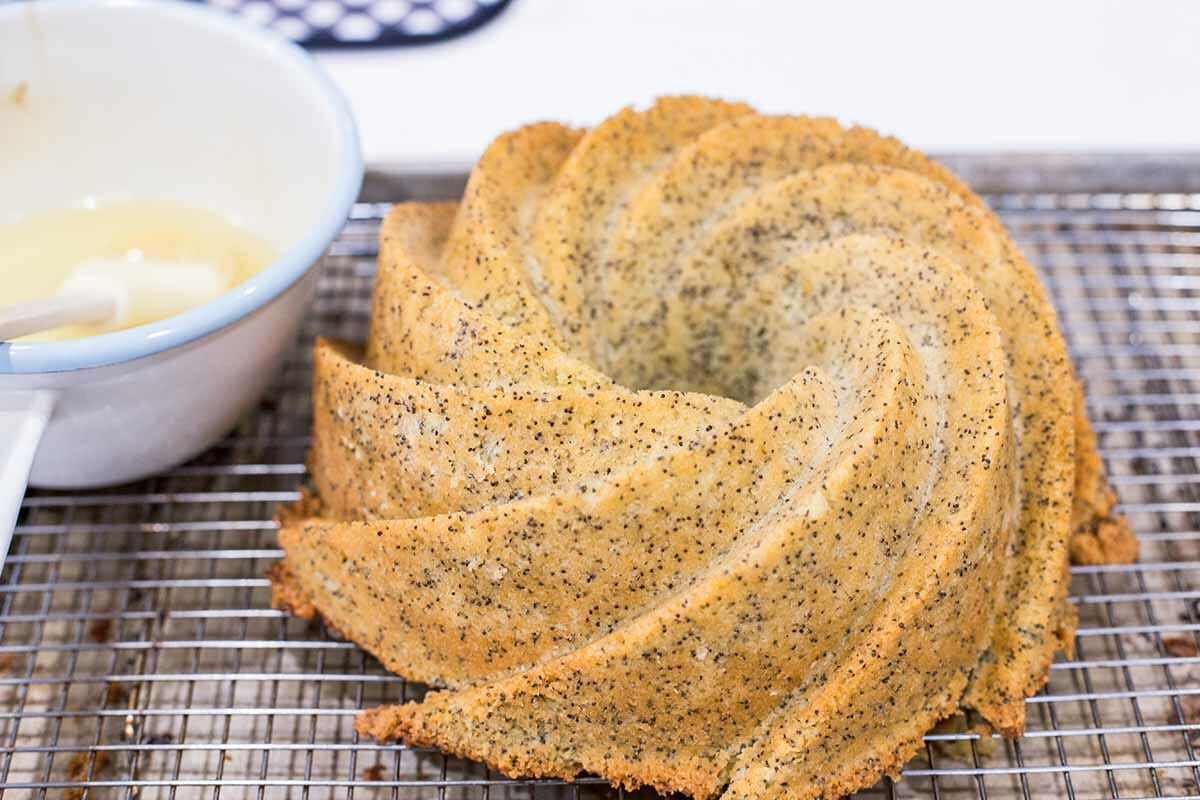 Homemade Lemon Poppy Seed Cake unmold and brush with syrup