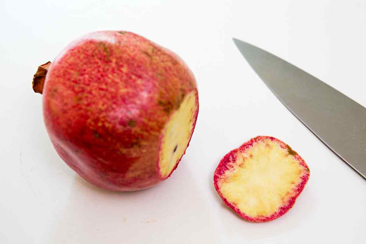how to cut a pomegranate - step 1 slice off bottom