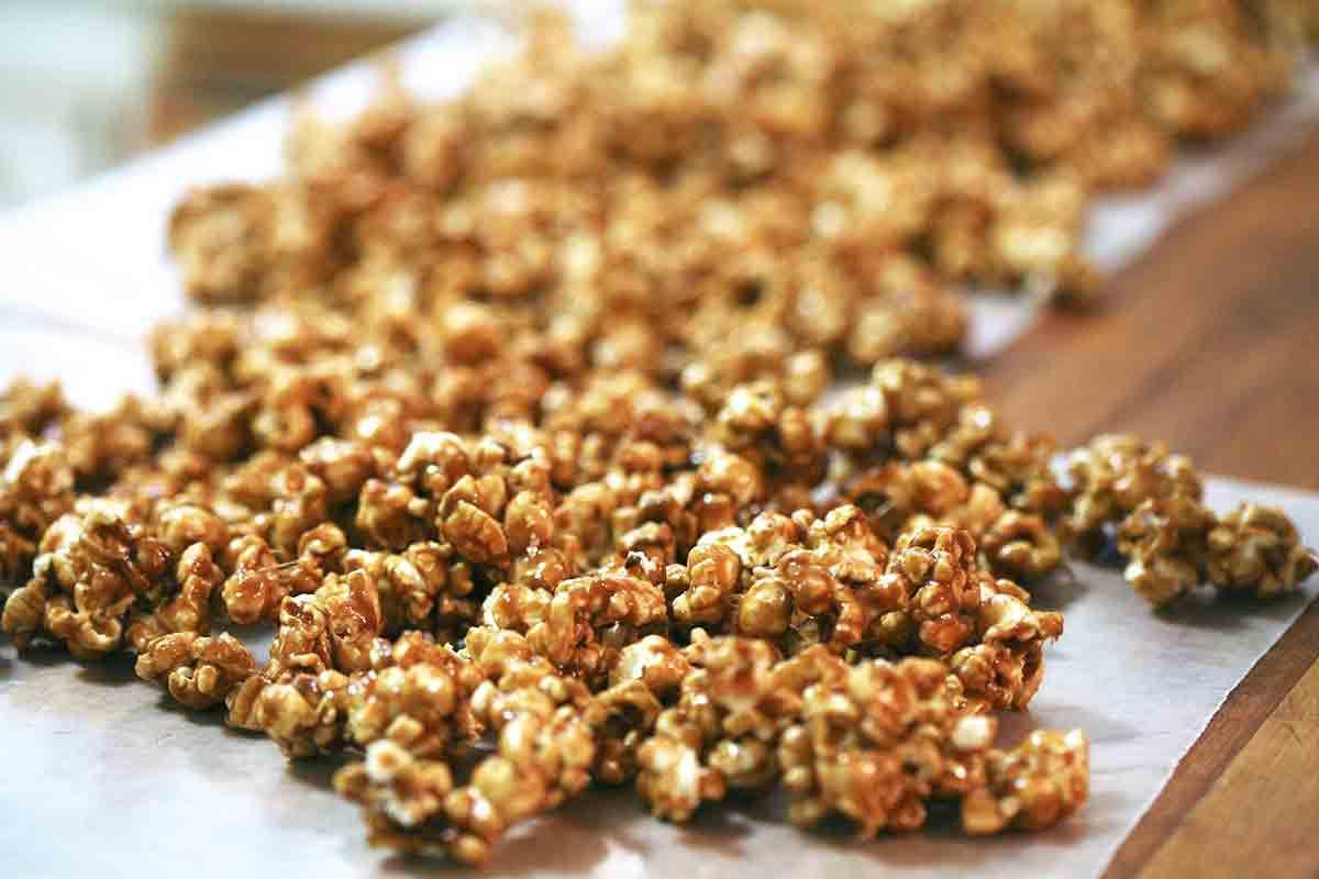spread caramel corn over parchment paper