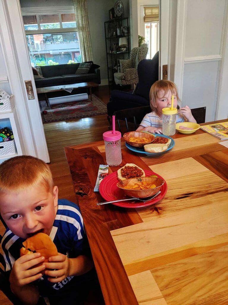 Kids eating vegan sloppy joes with lentils
