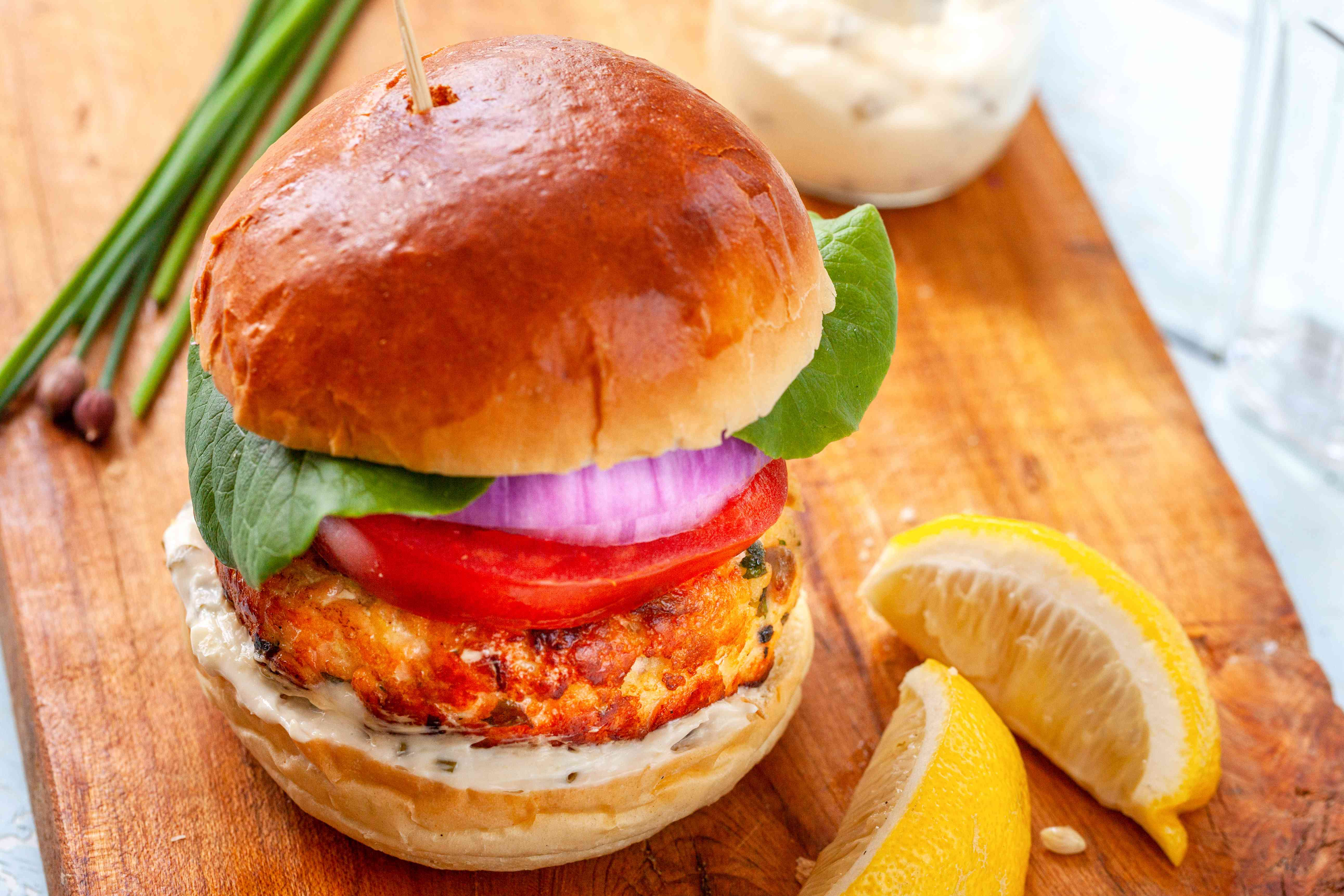 Perfect salmon burger on a wooden board.