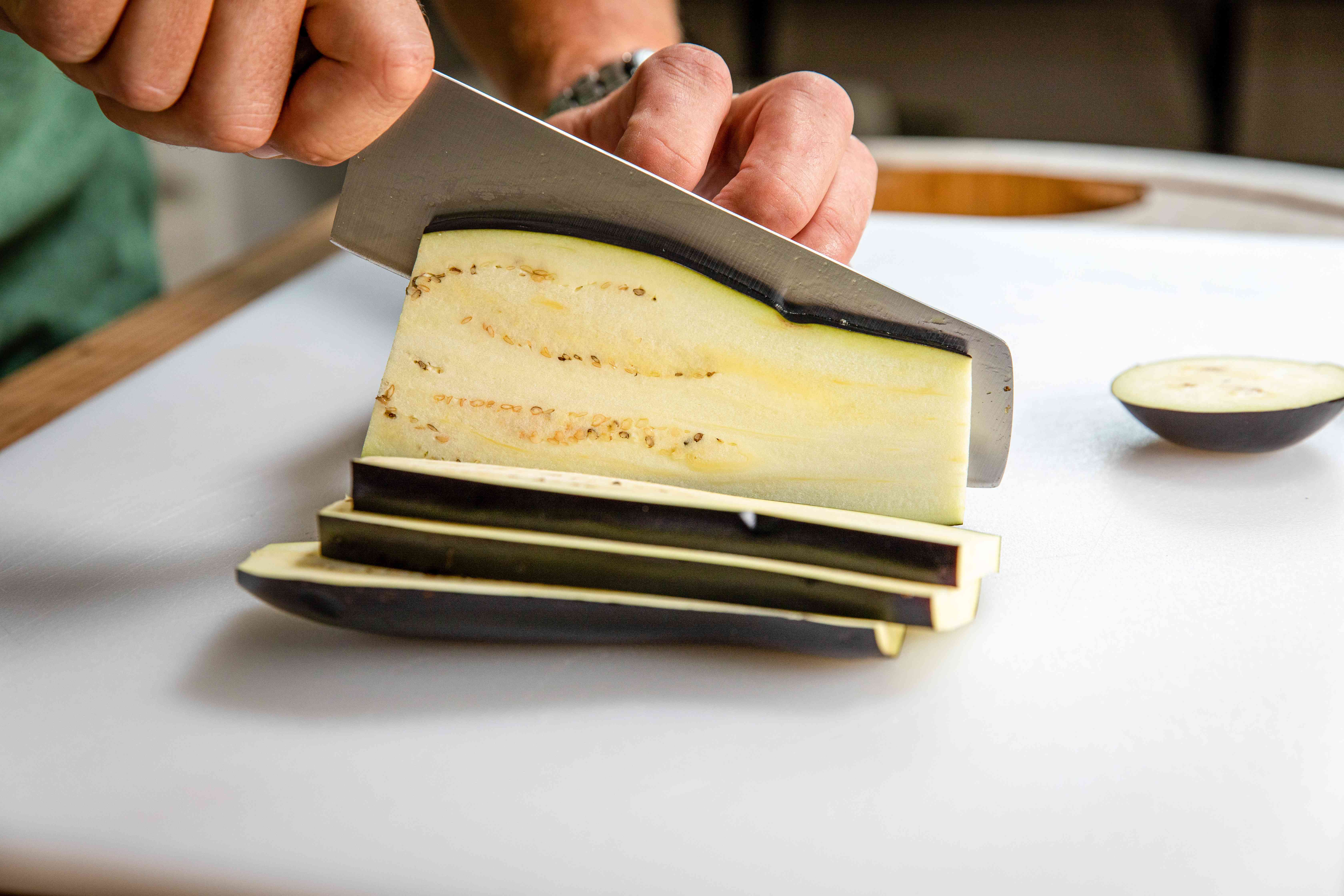 Thinly slicing eggplant to make easy grilled vegetable nachos.