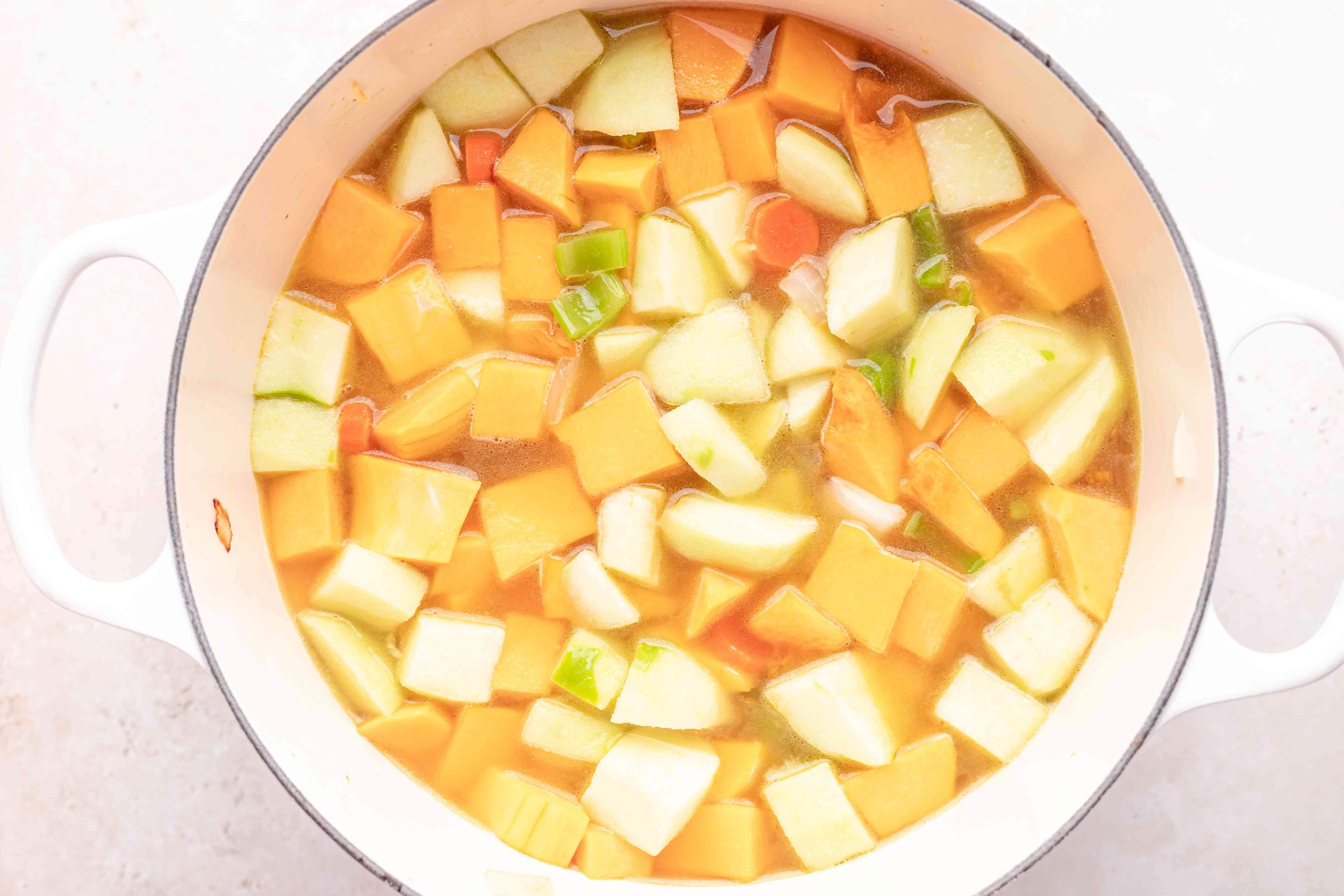 Making butternut squash soup recipe in a dutch oven.