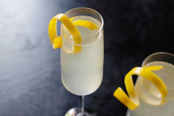 Fancy French 75 cocktail with champagne gin and simple syrup ingredients