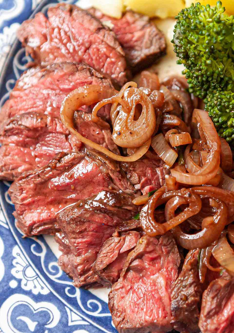 Easy stovetop hanger steak, sliced on a platter