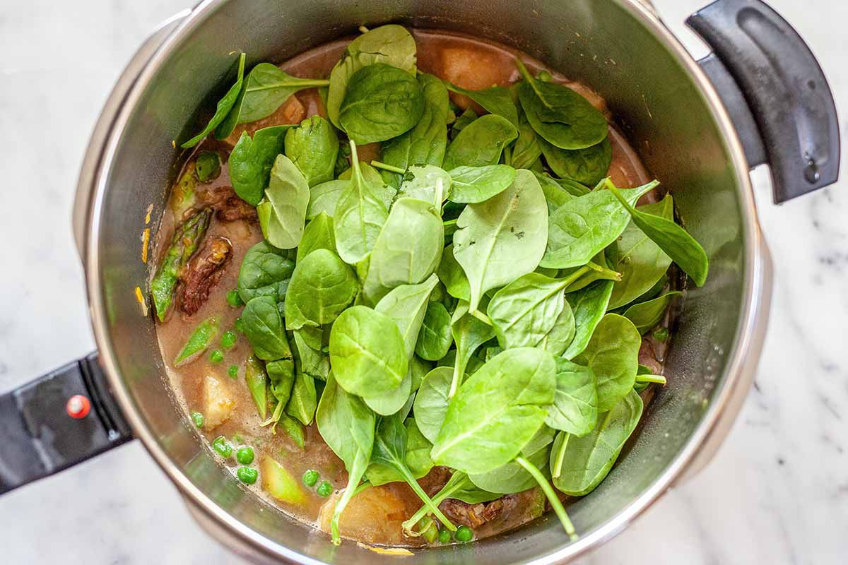 Lamb Stew - lamb stew in pot with spinach