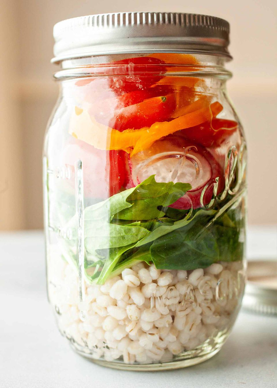 Mason Jar Barley Salad - layered barley and vegetables in mason jar