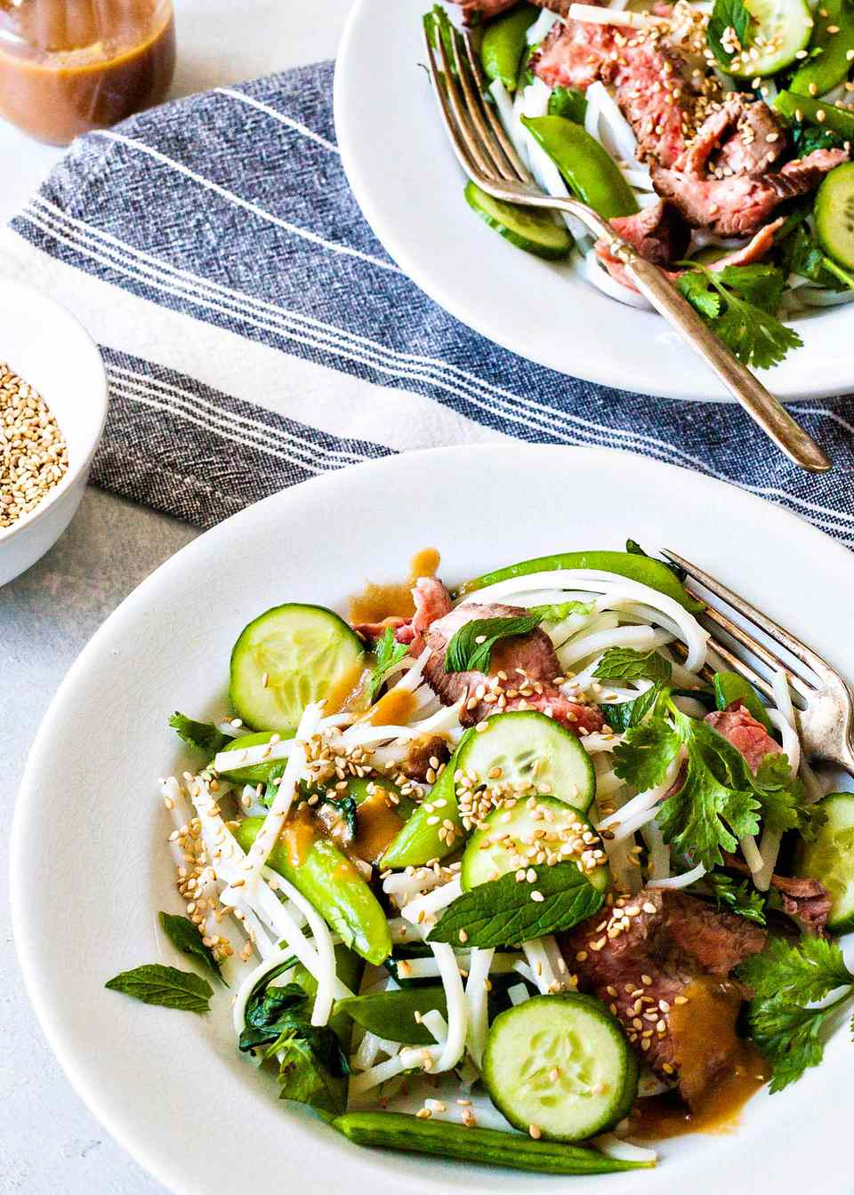 Beef Noodle Bowl - noodle salad with beef and vegtables in a white bowl