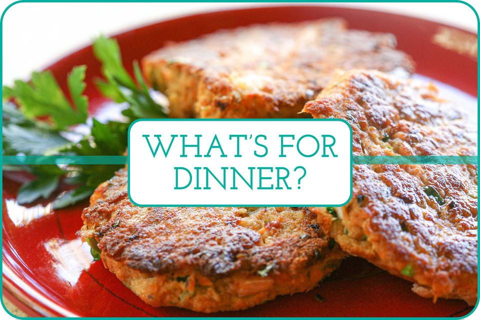 """""""What's for Dinner"""" written over a plate of three salmon patties."""