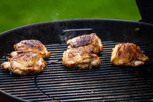 Chicken thighs on a Weber charcoal grill