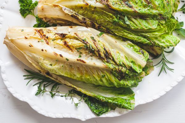 A platter of whole romaine in a romaine salad.