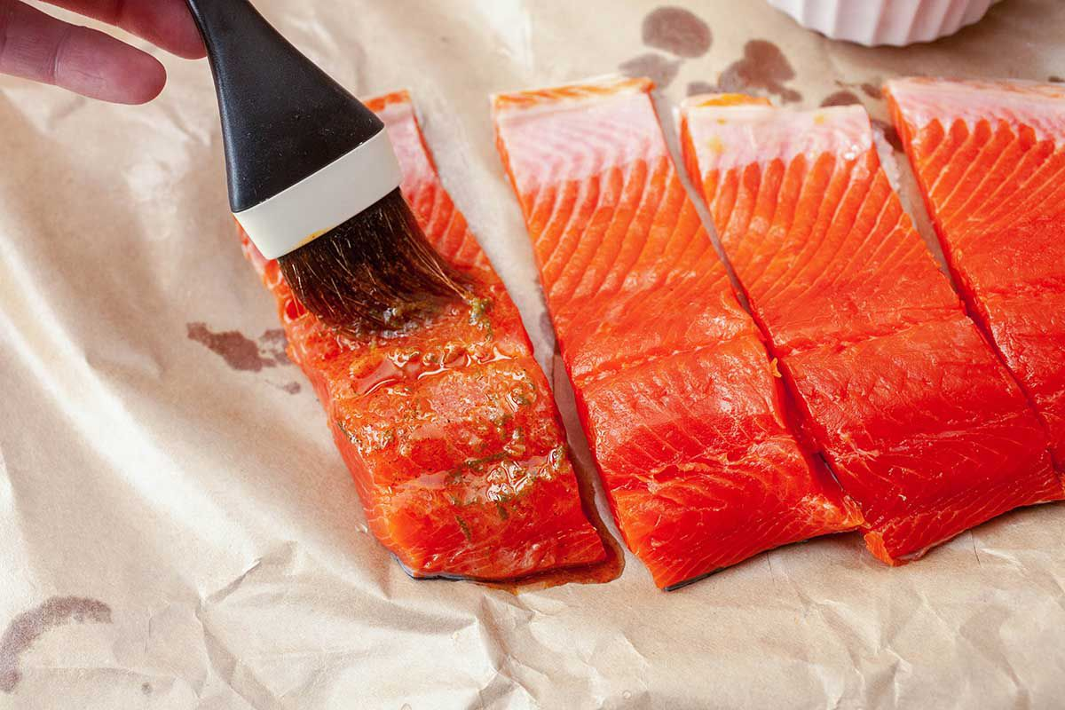 Grilled Salmon Fillet with Mango Salsa - brushing salmon with glaze