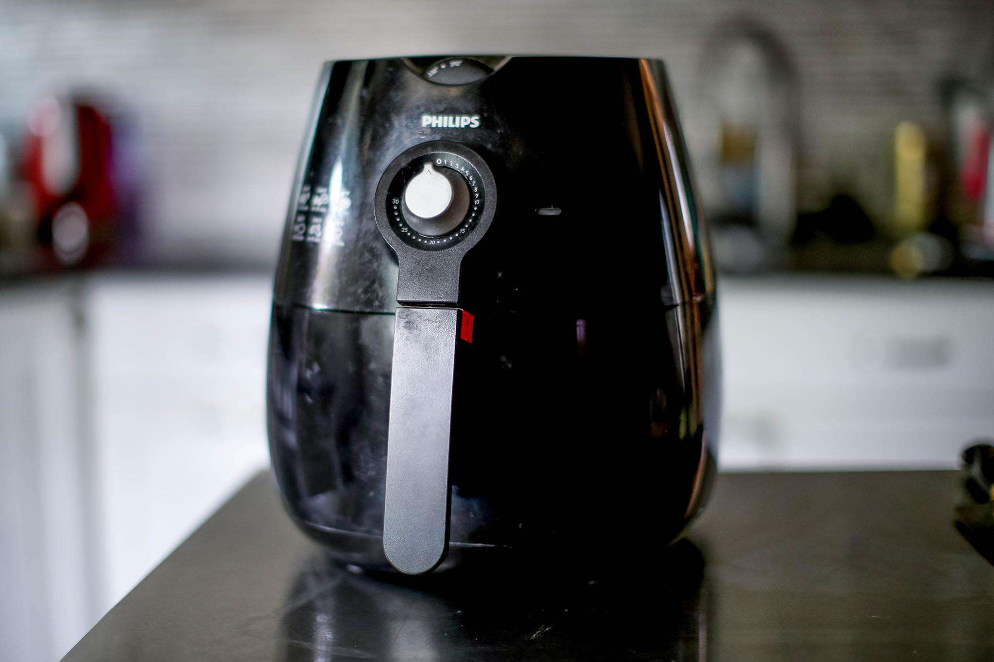 Air fryer on a counter top ready to be used