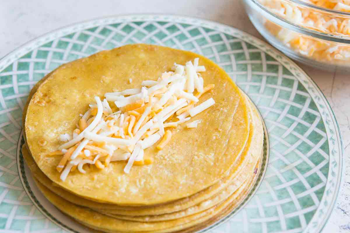 sprinkle inside of tortillas with cheese for enchiladas
