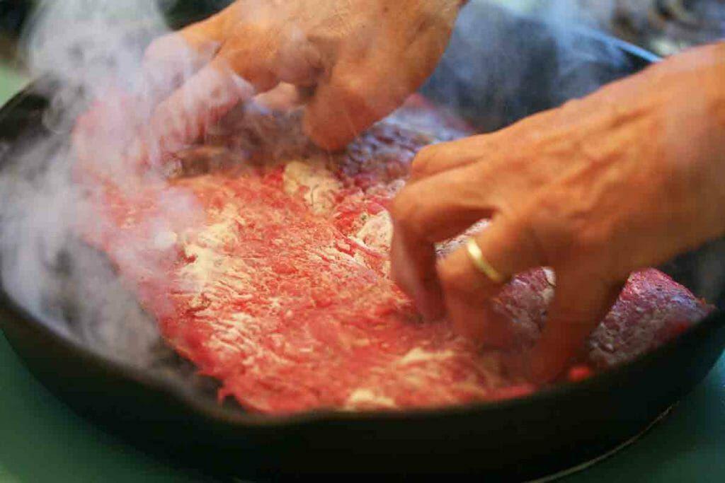 place flank steak in frying pan