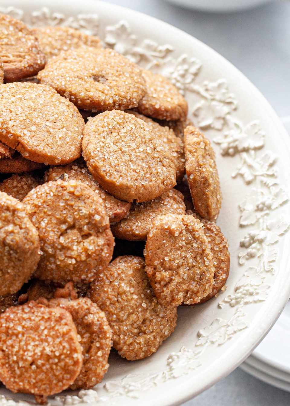 Close up of Make Ahead Slice and Bake Ginger Cookies in a footed serving bowl and coated with raw sugar.