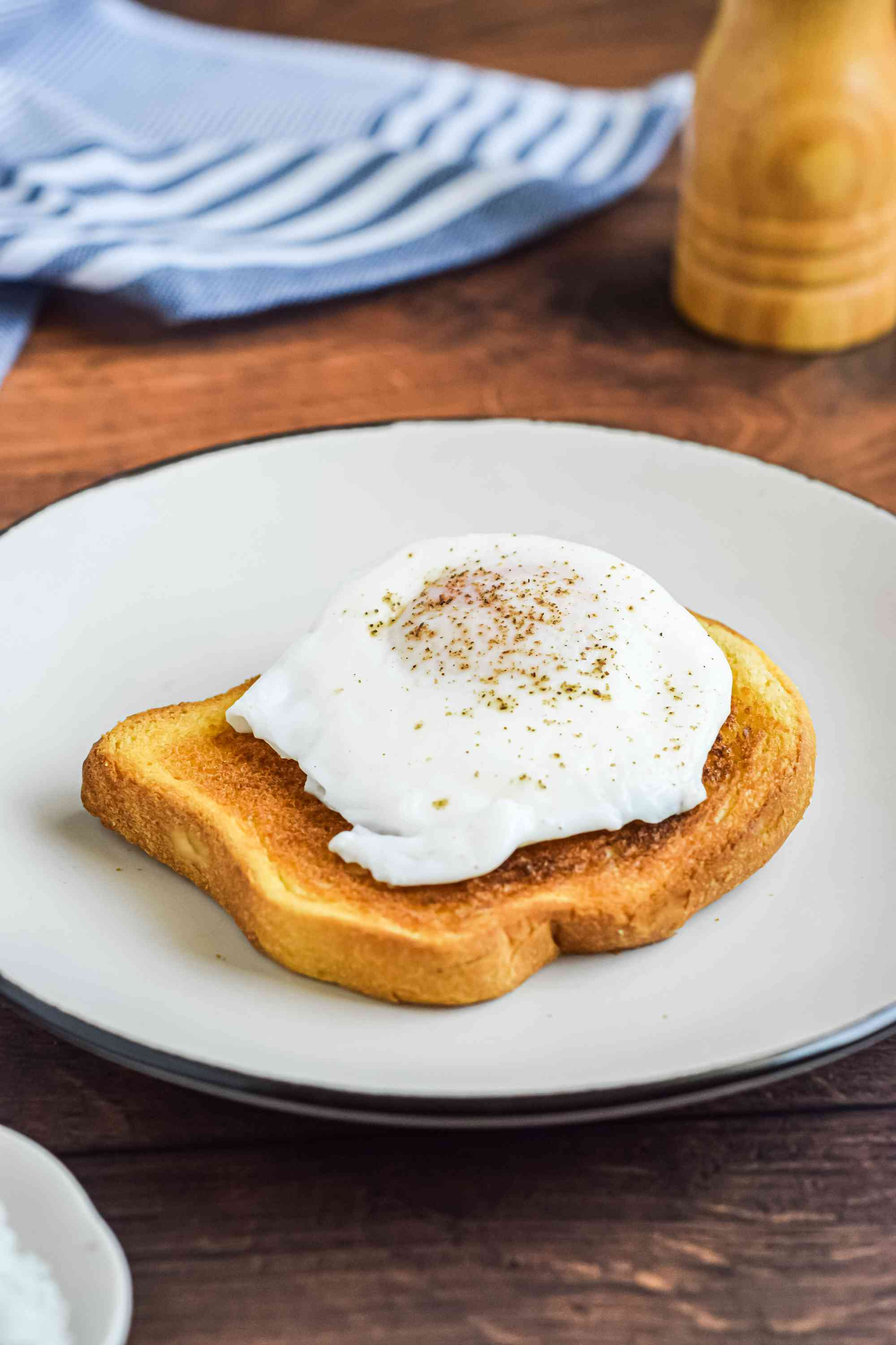 A plate with a poached egg on toast.