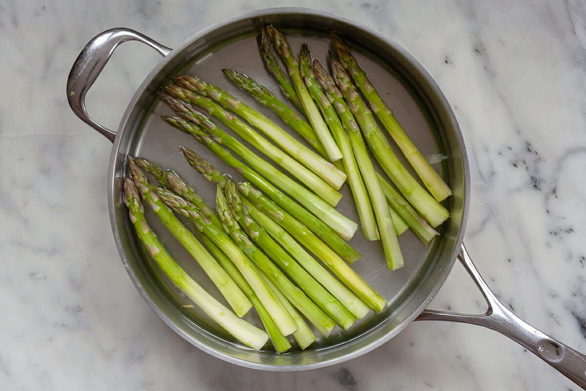 Bruschetta with Asparagus - peeled asparagus in pot of water